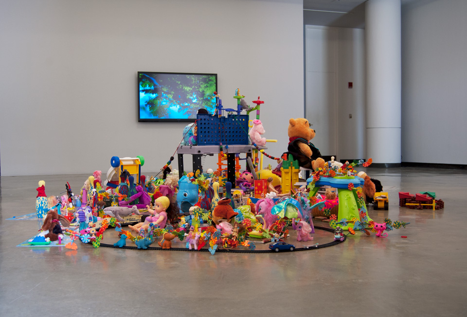 Joel Tauber's installation, The Sharing Project, explores the meaning of sharing via 15 short films, 21 interviews, and a communal sculpture of shared objects.